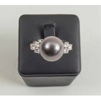 A SOUTHSEA BLACK CULTURED PEARL AND BRILLIANT DIAMOND DRESS RING