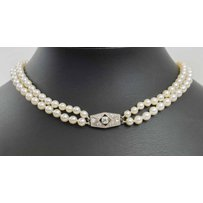 ART DECO TWO ROW GRADUATED CULTURED PEARL NECKLACE WITH DIAMOND CLASP.