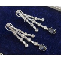 A PAIR OF ART DECO SAPPHIRE AND DIAMOND PENDANT EARRINGS