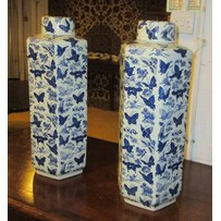 CHINESE STYLE JARS WITH COVERS