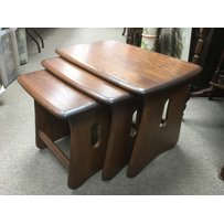 An Ercol nest of three Windsor tables