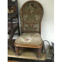 A Victorian walnut chair with floral needlepoint upholstery