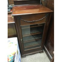 An Edwardian mahogany cabinet fitted with a single glazed door