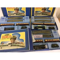 Included are 3 hornby double 3 rail sets, including 2 duchess of Montrose and 1 silver king.