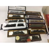 Included are 7 oo gauge locomotives and 4 boxed coaches.