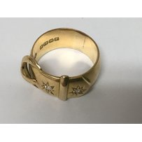 A 18 ct gold buckle ring inset with two diamonds 12 grams