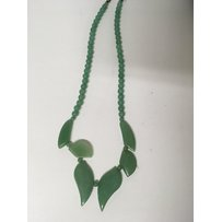A hard stone green necklace of Art Deco style in a fitted bo…