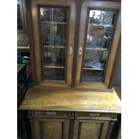 A Victorian walnut bookcase with glazed and solid cupboard d…