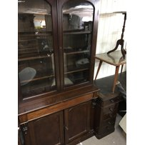 A Victorian mahogany bookcase the pair of glazed doors above…