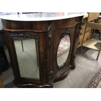 A Victorian marble top credenza with central mirror cupboard…