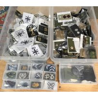 An extensive collection of assorted military cloth badges an…