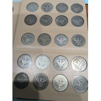 An Album containing a complete set of Silver Liber…