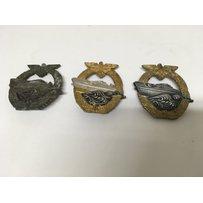 A group of three German Kriegsmarine badges, likely U Boat.