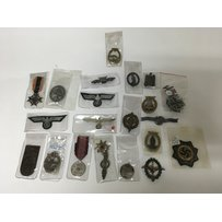 A large assortment of German third reich badges including SS…