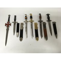 A group of replica German daggers including one bearing RZM …