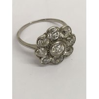 A 1920's white gold diamond cluster ring, set with old cut d…