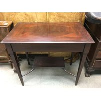 An Edwardian mahogany occasional table with a single drawer.…
