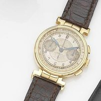 Longines. An 18ct gold manual wind flyback chronograph wristwatch