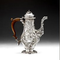 A George II silver rococo chinoiserie coffee pot