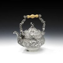 An impressive George IV silver swing-handled kettle