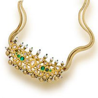 A gold and gem-set necklace